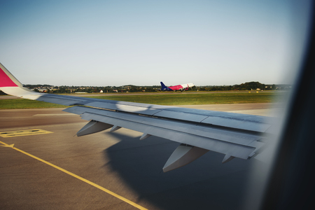 landing of an airplane in international airport, looking through window of aircraft