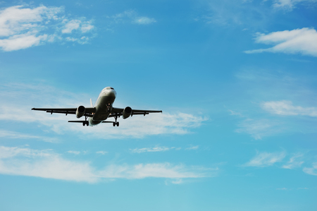 landing of an airplane in international airport, blue sky Stock Photo