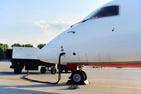 Ground crew charging battery of airplane. Aircraft is preparing for taking off.