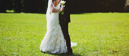 lovely bridal couple embracing, happy wedding, bride and groom together
