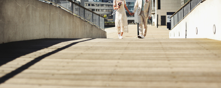 bridal couple walking through the park