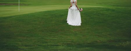 beautiful bride in stylish wedding dress holding a bouquet Stock Photo