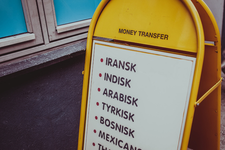 Money exchange place sign with different currencies