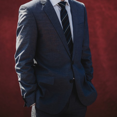 A man posing in a suit, classic wear