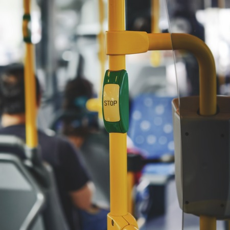 Stop button in the bus. Urban transportation