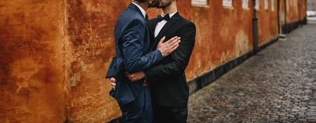 Same sex gay couple walking around the city. 免版税图像