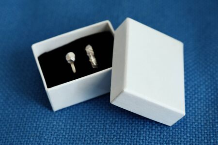 A pair of silver wedding rings in a box.