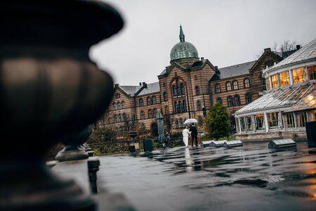Bridal couple is walking on a rainy day in Copenhagen. 스톡 콘텐츠
