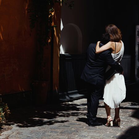 Bridal couple embracing, just married groom and bride. 스톡 콘텐츠