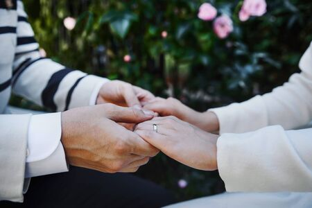 Bridal couple is ready for getting married, happy bride and groom holding hands.