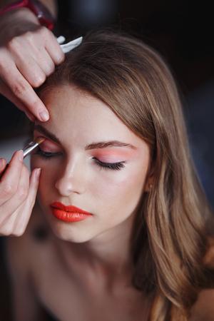 Makeup artist does makeup for the model 写真素材