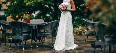 Wedding photo of an elegant bride with a bridal bouquet.