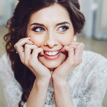 A fashion model posing wearing wedding dress.