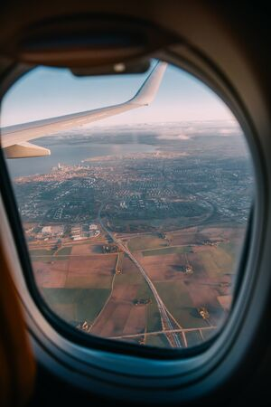 The plane flying over Gdansk, aircraft cabin view.