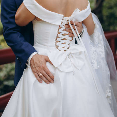 Wedding couple embracing. Love and tenderness of the newlyweds