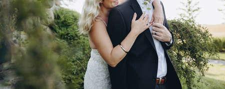 Bridal couple together celebrating happy wedding day. Reklamní fotografie