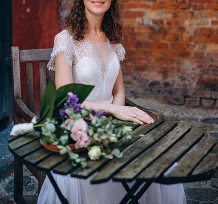 Beautiful bride wearing classic white wedding dress.