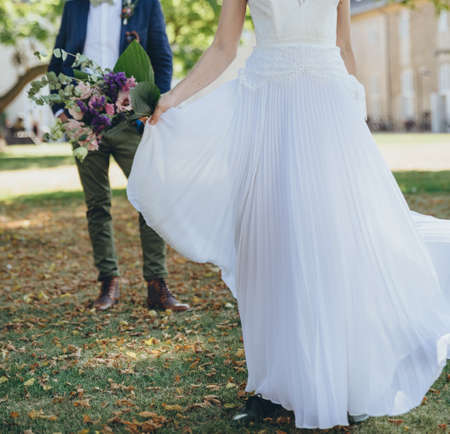 Young fashion bridal couple together celebrating happy wedding.