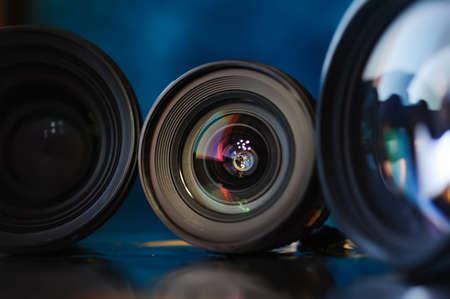 Standart camera lens with aperture inside, colorful reflection. Banco de Imagens