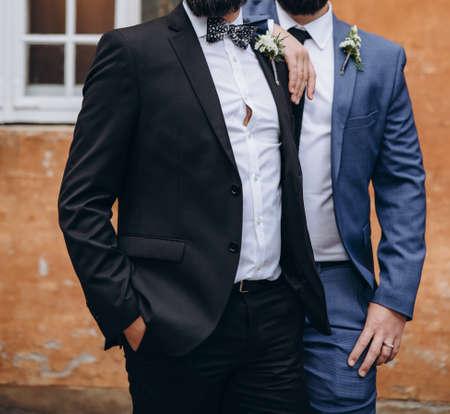 Newlywed stylish couple on their happy wedding day. Equality concept. Standard-Bild