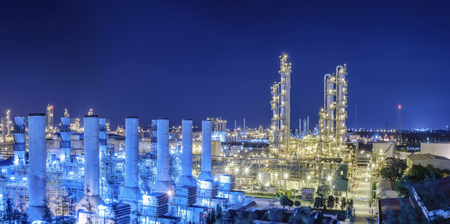 Petrochemical plant and lighting at night, Oil and gas refinery industry with night sky background