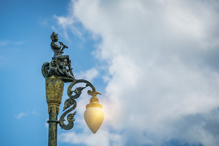 Lamppost street road on blue sky background