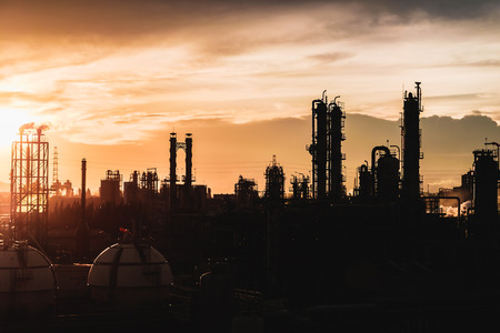 Petrochemical plant on sky sunset, Petrochemical plant in silhouette image Stock Photo