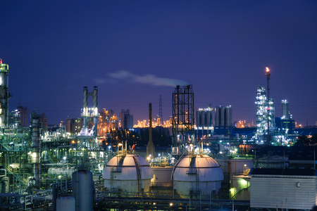 Glitter lighting of petrochemical plant on blue sky twilight background, Manufacturing of petroleum industry