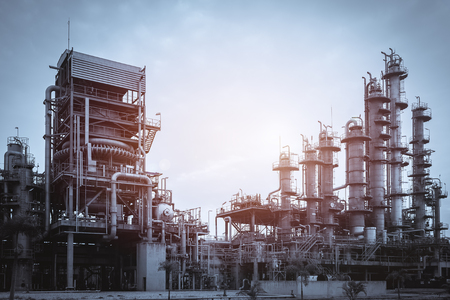 Manufacturing industry plant with production line and gas distillation tower on retro vintage effect Stock Photo