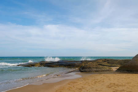 Sand beach and rock on blue sky summer with white cloud Stockfoto