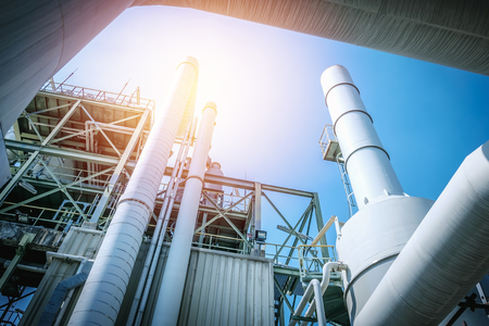 Pipeline of industrial plant with sunlight on blue sky background