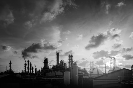 Manufacturing of petroleum industrial plant with black and white effects on sky with cloud background Redactioneel