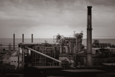 Old factory building with monotone effect on sky background
