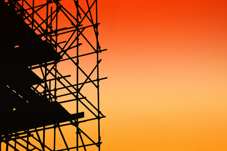 Silhouette of scaffolding on sunset sky background Stockfoto