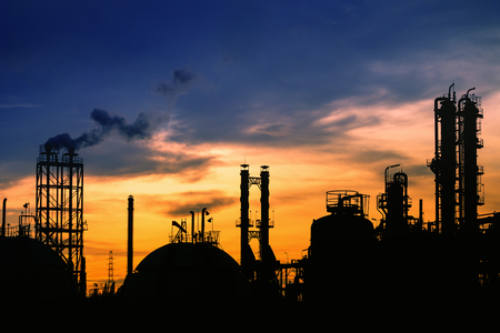 Silhouette petrochemical industrial plant on sunset sky background