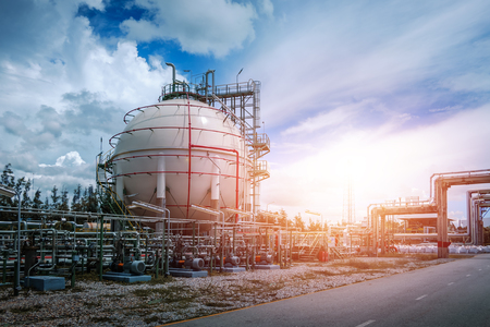 Gas storage sphere tank in oil and gas refinery plant or Petrochemical industry on blue sky sunset with white cloud Redactioneel
