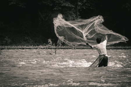 Fisherman was fishing in the river with net