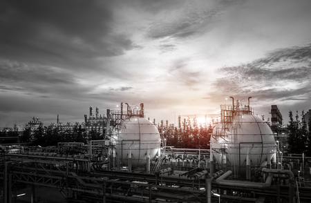 Gas storage sphere tanks and pipeline in oil and gas refinery industrial plant on sky sunset background Redactioneel