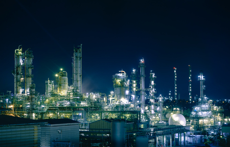 Glitter lighting of petrochemical plant with night, Manufacturing of petroleum industrial plant
