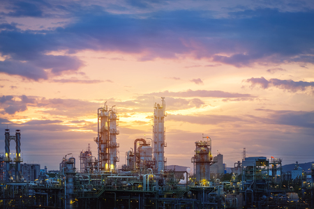 Manufacturing of oil and gas refinery industrial or Petrochemical industry plant on sunset sky background