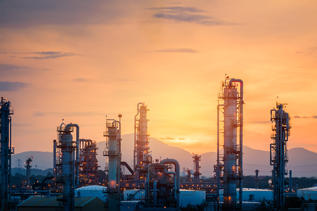 Gas refinery plant on sunset sky background, Manufacturing of petrochemical industrial plant with distillation tower and pipeline on sunrise sky background