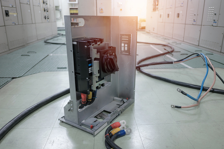 Electrical substation room in petrochemical industry or Oil and gas refinery and power plants, Switchgear or beaker with wire connect concept