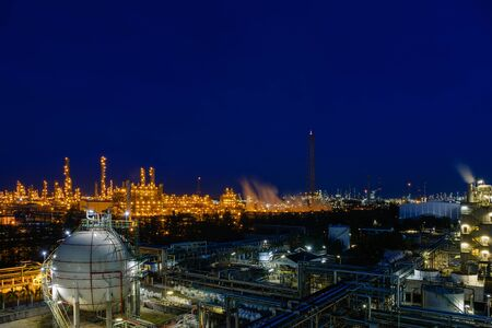 Petroleum industrial plant at twilight time, Manufacturing of petrochemical industrial, Oil and gas refinery