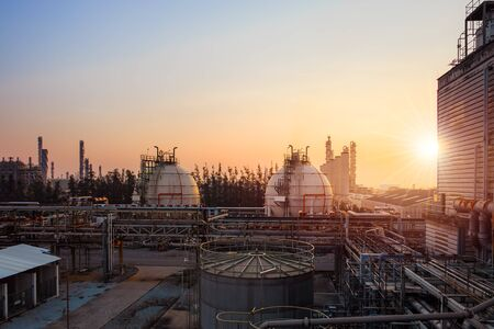 Gas storage sphere tanks and pipeline in petrochemical industrial plant on sky sunrise background, Manufacturing of petroleum industry plant
