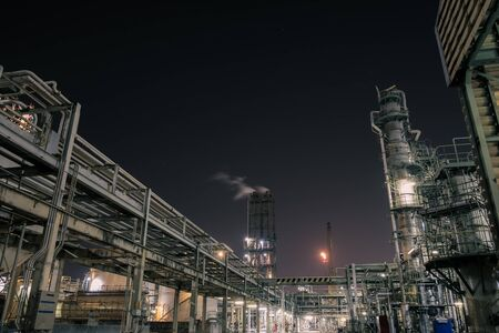 Pipeline and pipe rack of petroleum industrial plant at night