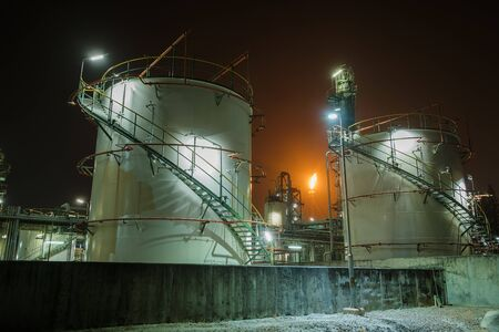 Gas storage tanks in factories at night, Manufacturing of petroleum industry