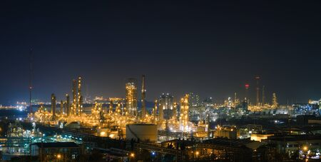 Panorama of glitter lighting Petrochemical industrial estate at night