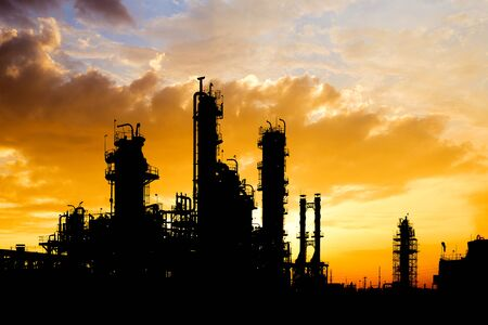 Oil and gas refinery industry in silhouette image on orange sky sunset background, Petrochemical plant, Factory with evening
