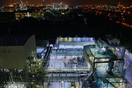 Top view of petrochemical plant, Manufacturing of chemical industrial plant, Glitter lighting of industry estate