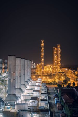 Factory of oil and gas refinery industrial plant at night, Manufacturing of petroleum industrial plant, Smoke stacks of power plant